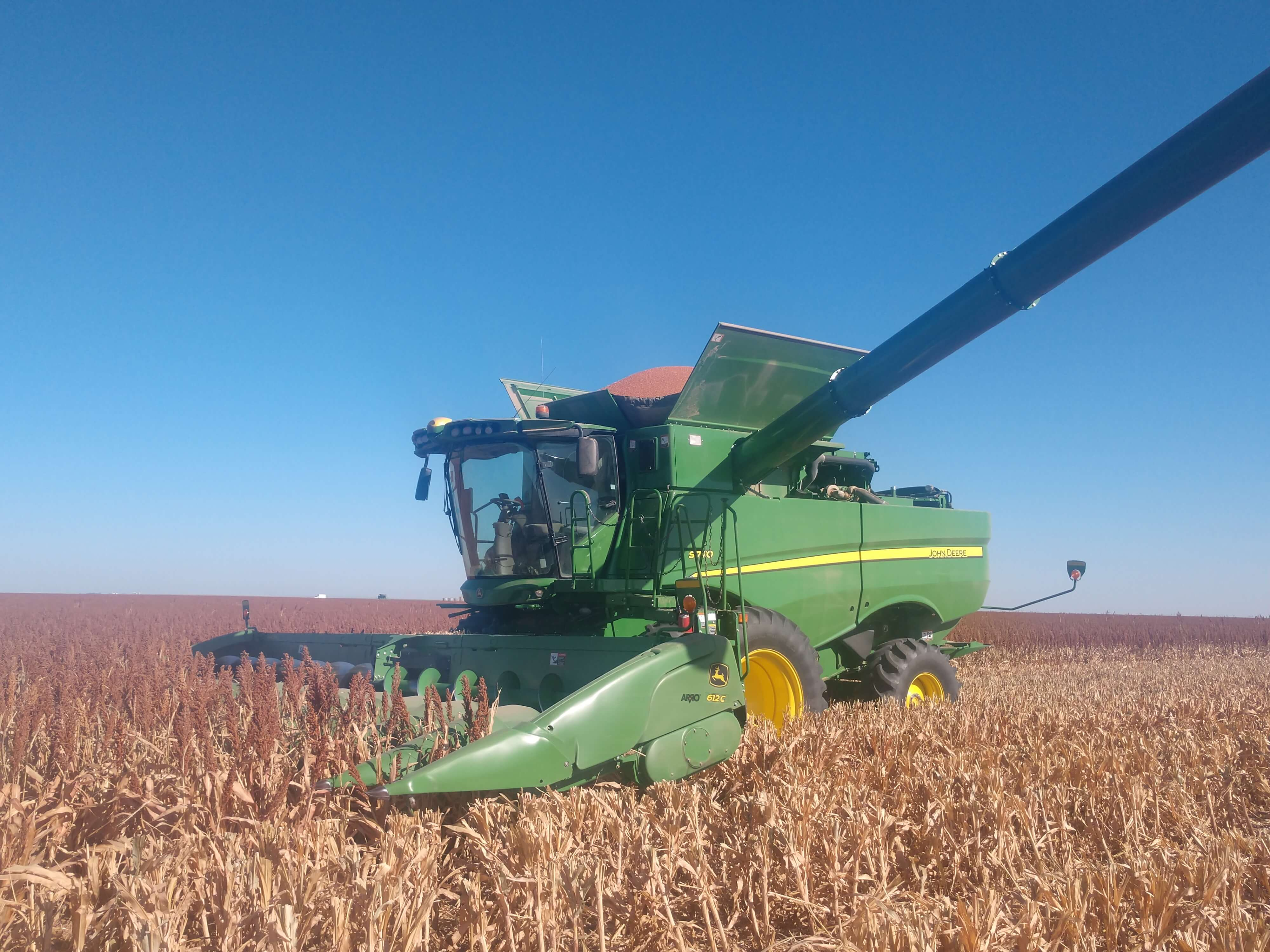 Green John Deere combine using ARRO®.